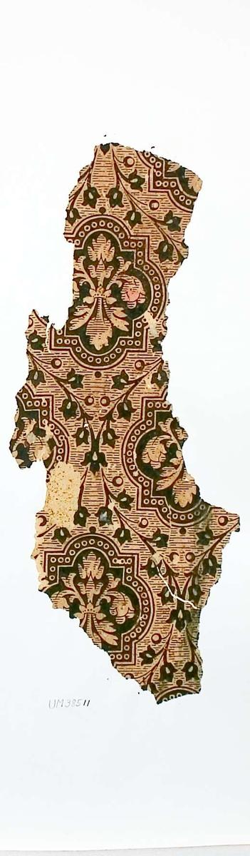 Tapetprov med tryckt mönster i grönt och gult. Kartongen är numrerad på baksidan: 160 12.