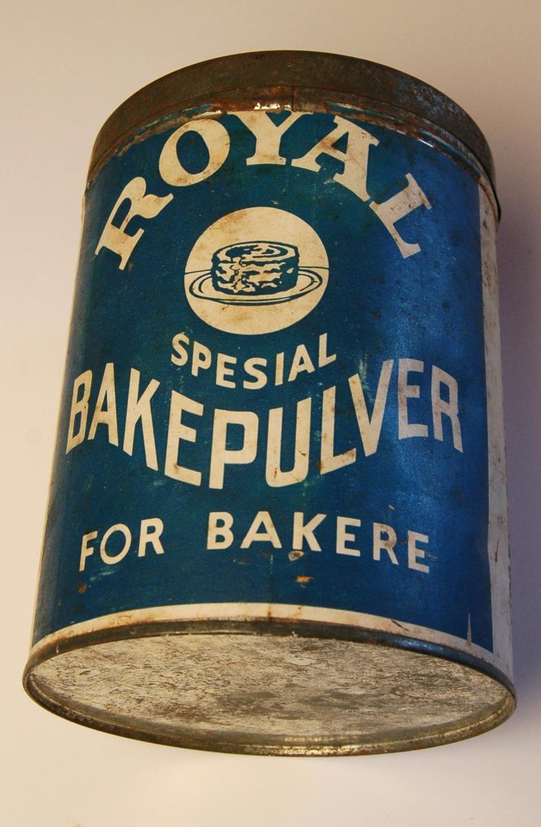 Sylinderforma boks av blekk med avtagbart lokk og med etikett av papir.