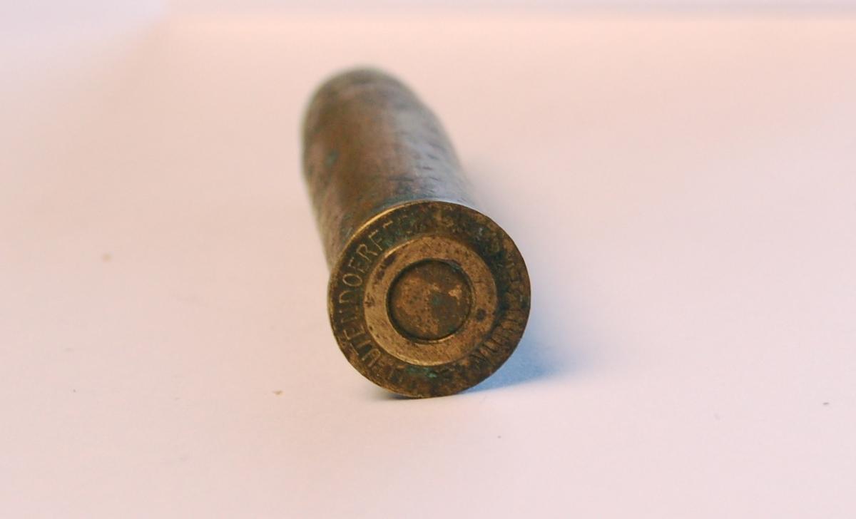 Fulladet rørformet geværpatrone i 12,17 mm. med blykule.