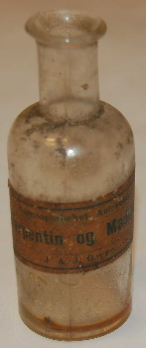 Rund sylindrisk flaskeformet medisinglas.