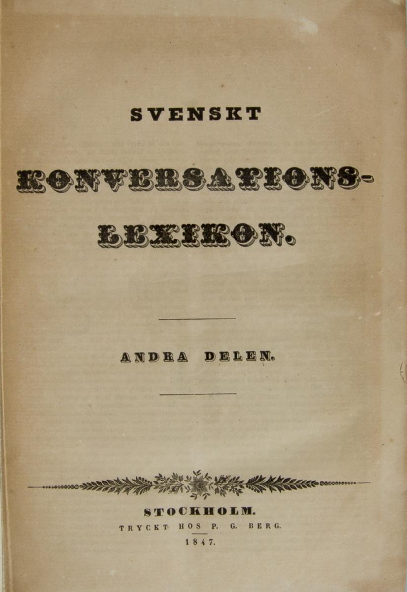 """Bok, halvfranskt band: """"Svenskt konversations lexikon, H - M"""", volym 2.  Bandet med blindpressad och guldornerad rygg. Pärmen klädd i marmorerat papper i grått, blått och brunt."""
