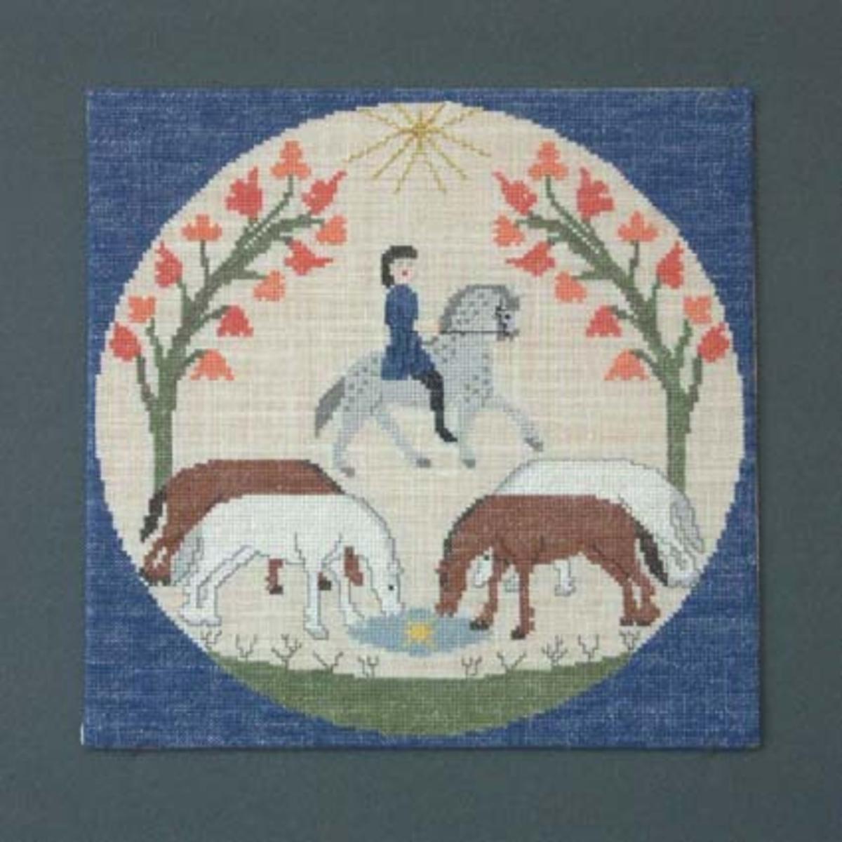 Julbonad med korsstygnsbroderi på linneväv. Bonaden tillhör Runda serien som är en serie julbonader formgivna av Irma Kronlund, en bonad per år från 1971 till 1989.
