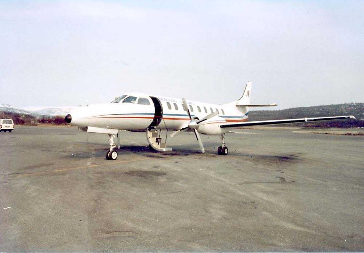 Lufthavn. Ett fly på bakken, Fairchild Swearingen Metro III fra Norving.