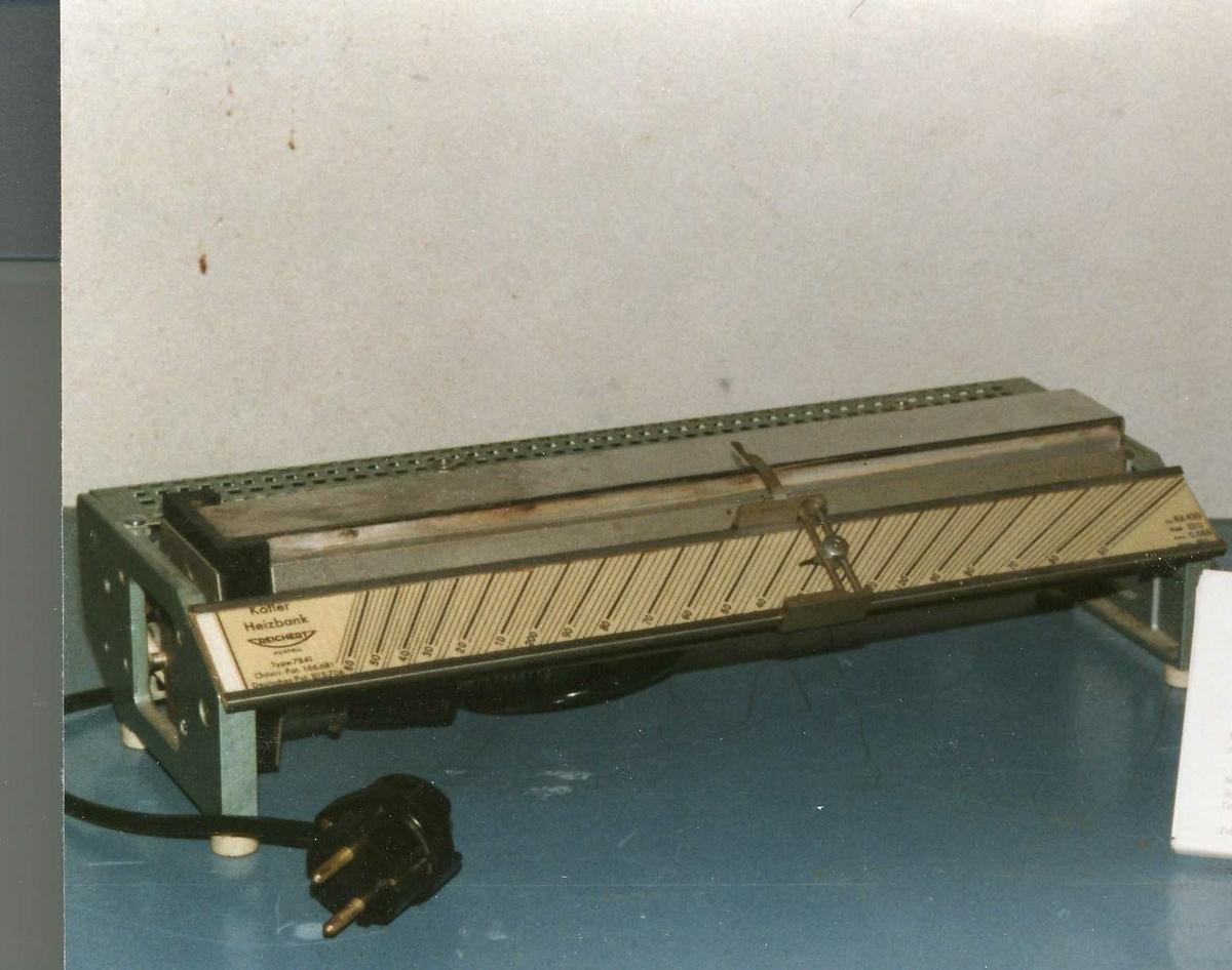 Apparat at metall, med temperatursoner i den blanke horisontale flaten.