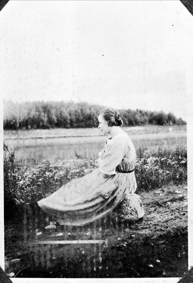 Kvinne, landskap