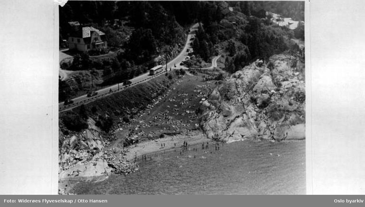 Ved Ljansbruket. Bildets originale tittel Bestemorstranda er feil. Badeliv, Ingierstrandveien (Flyfoto)