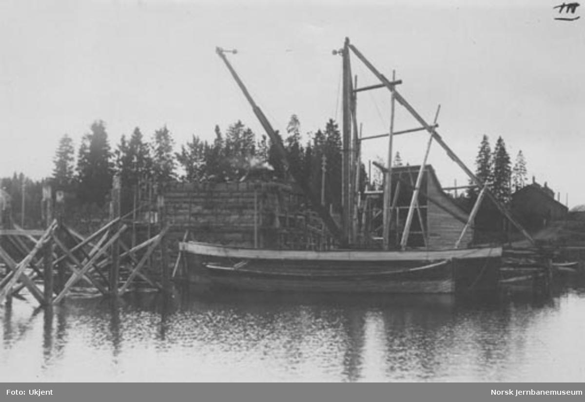 Bru over Snåsavatnet : muring av landkar 1