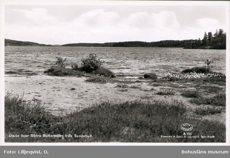 """Tryckt text på kortet: """"Utsikt över Södra Bullaresjön från Sundshult."""" """"Förlag: O. & S. Helgen. Bullaren."""""""