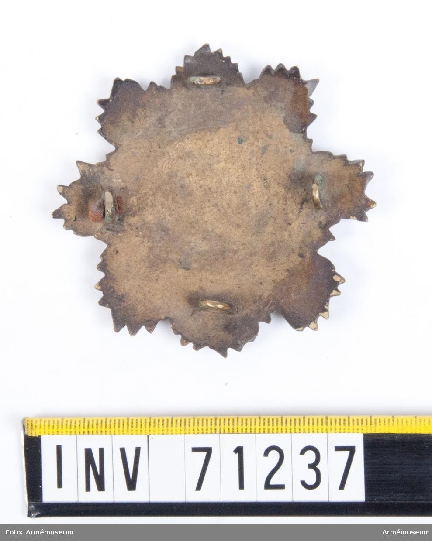 Grupp C I. I en av öglorna på baksidan sitter rester av en läderrem.