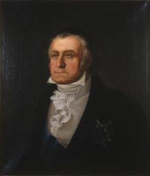 Portrett av Peder Anker. Mørk drakt, hvit vest og skjorte. Blått ordensbånd, orden festet på brystet. (Foto/Photo)