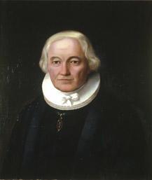Portrett av Grøgaard (Grøgård). Prestekjole og -krave. Medalje i grønt bånd om halsen.