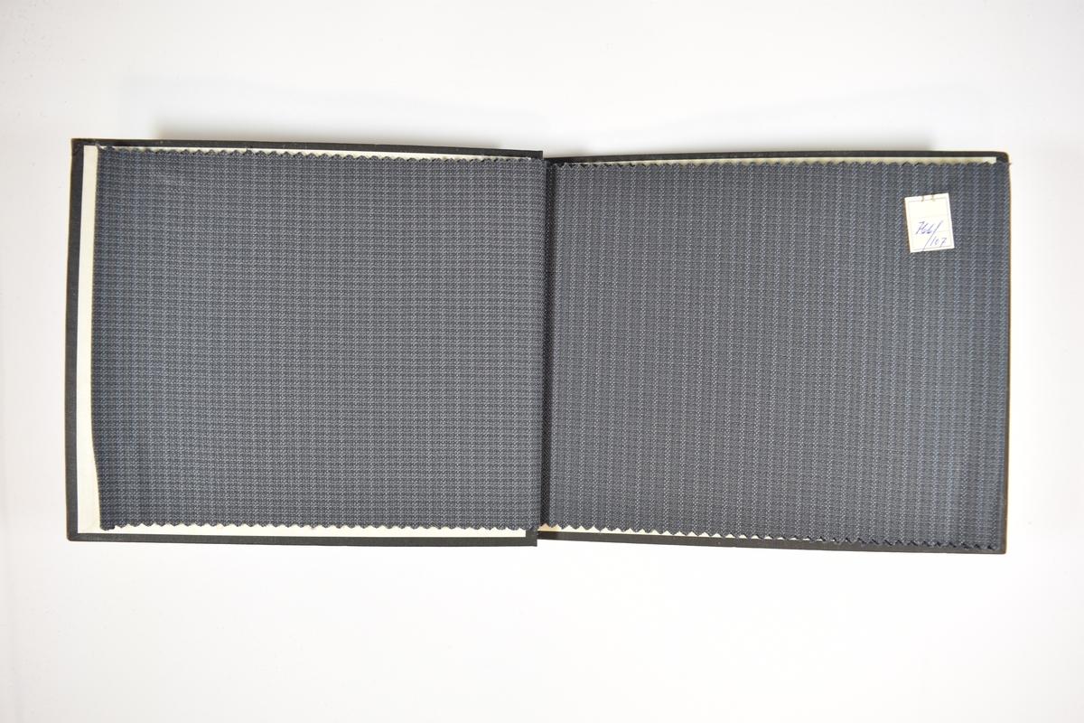 Prøvebok med 8 stoffprøver. Relativt tynt stoff med vertikale striper med mer. Stoffet ligger brettet dobbelt i boken slik at vranga dekkes. Stoffet er merket med en firkantet papirlapp, festet til stoffet med metallstifter, hvor nummer på påført for hånd.   Stoff nr.: 766/106, 766/107, 766/108, 766/109, 766/110, 766/111, 766/112, 766/113.