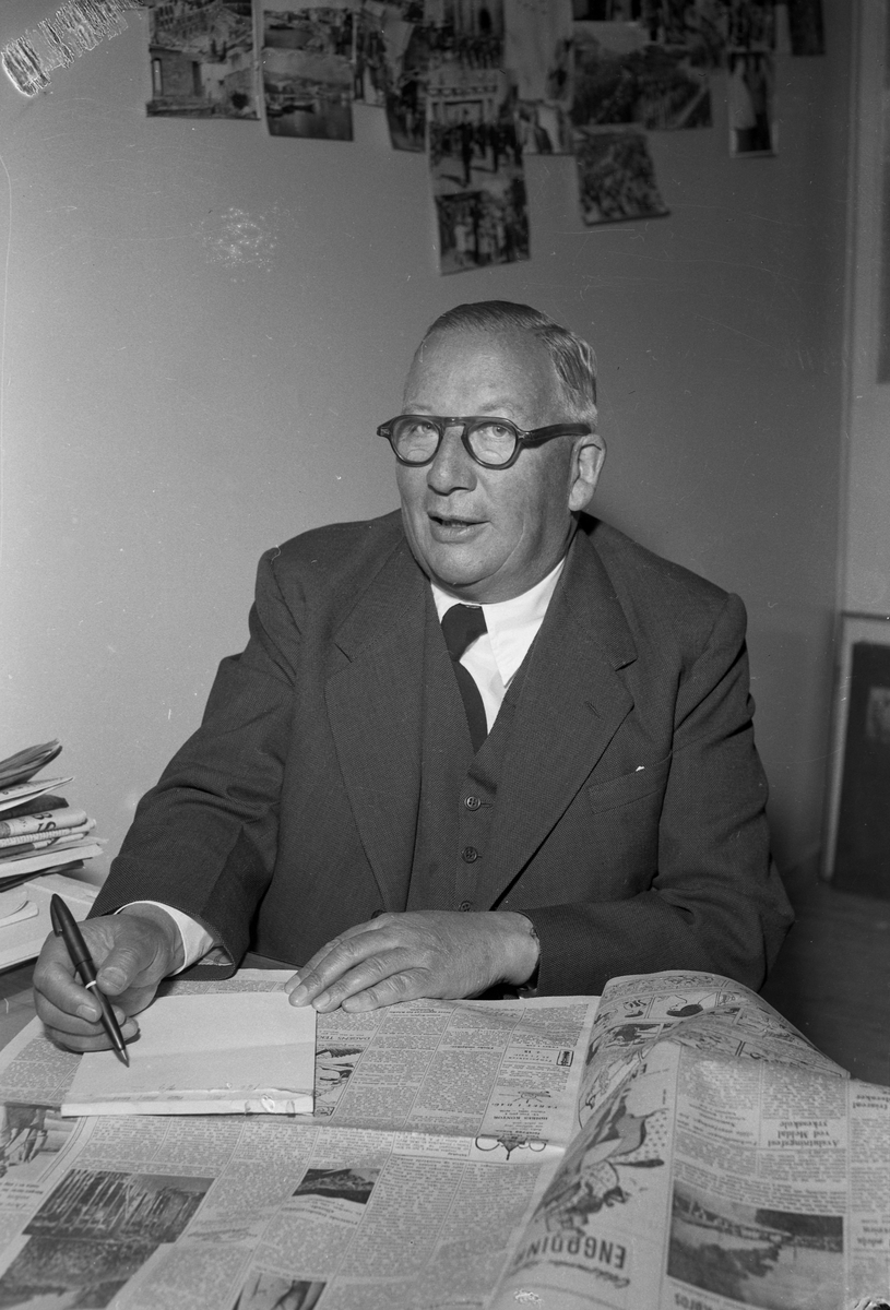 Direktør Sir Lloyd Dumas - avismann fra Australia