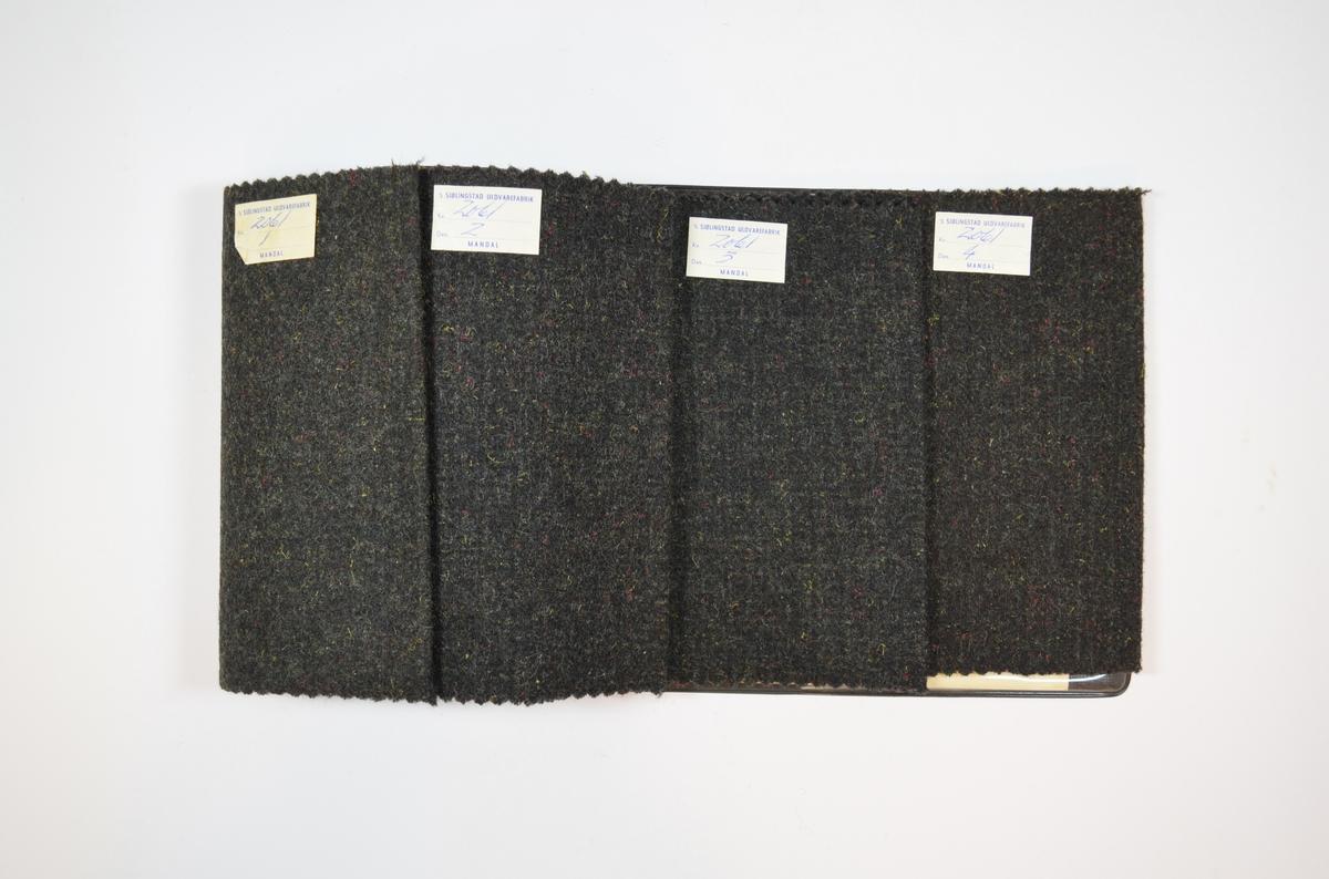 Prøvehefte med fire prøver. Middels tykke tovet/valkede stoff bestående av flere farger jevnt fordelt. Stoffene ligger brettet dobbelt i heftet. Stoffene er merket med en firkantet papirlapp klistret til stoffene, hvor nummer er påført for hånd i et trykket skjema. Heftet har stiv bakplate og en papp-plate der heftet er stiftet som dekker ca. 5 cm forsiden. I en plastlomme på innsiden av bakplaten er det en papirlapp med informasjon om stoffet, hvor det blant annet beskrives at bruksområdet for disse stoffene er til blazers.    Stoff nr.: 2061/1, 2061/2, 2061/3, 2061/4.