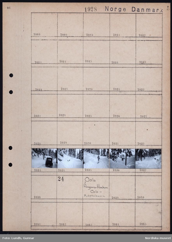 Motiv: Norge, Oslo, Holmenkollen; Snötäckt skog, bil i snötäckt skog, skidåkare i snötäckt skog.  Motiv: Norge, Oslo, Ångaren Haakon, Oslo - Köpenhamn;  Ej kopierat.