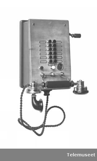 Telefon, lokal, veggapparat i tre med magnetolinje, Duplex (janusapp.) app. for 12lj., mtlf.liggende, klokke likestrøm, 30.3.1915. Elektrisk Bureau.