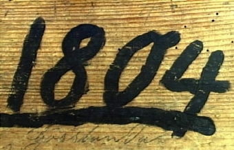 """Rektangulär ostform med intappade sidor. I bottnen skuren dekor i form av 5 st. rosetter samt """"1872"""". Utanpå en långsida är målat """"1804"""". Inköpspris 1:50.   Neg.nr: 1985-0004 Sakord: OSTFORM Tillverkningstid: 1804? Material: FUR Teknik: TAPPAT SKURET Mått: L=357  B=288  H=168 Vikt:"""