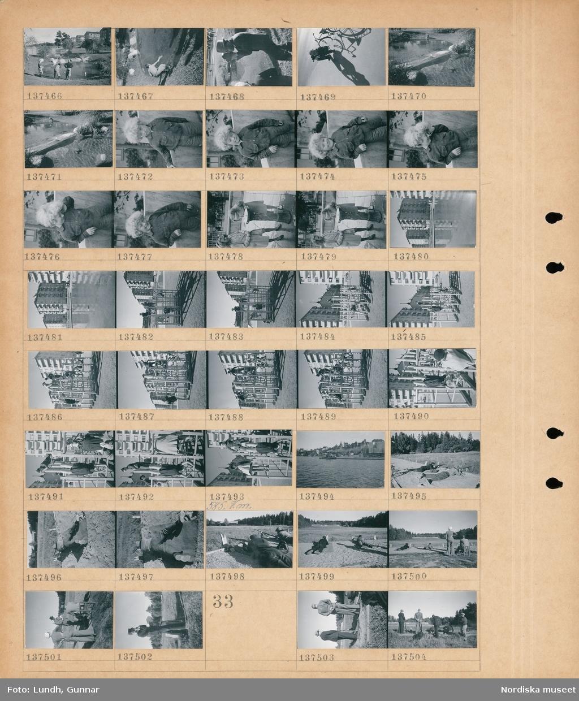 Motiv: (ingen anteckning) ; Barn leker vid en damm, en man som filmar med en filmkamera, porträtt av ett barn, två flickor vid en dricksfontän, stadsvy med plaskdamm och hyreshus, barn klättrar i en lekställning, stadsvy med hamn och fartyg och bebyggelse, män skjuter med gevär på en skjutbana.