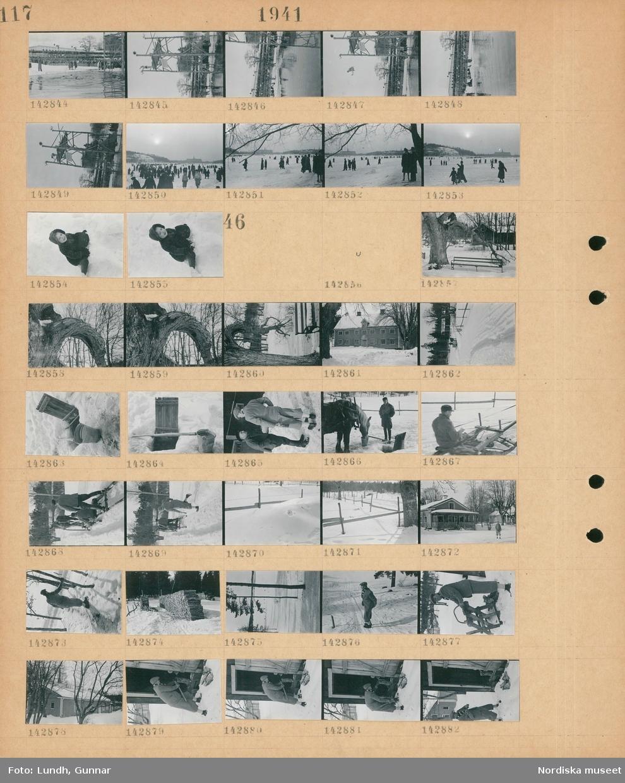 Motiv: (ingen anteckning) ; En folksamling nedanför Sjöhistoriska museet tittar på simning och människor som simhoppar från hopptorn ner i en isvak, en folksamling går över isen på Djurgårdsbrunnsviken, porträtt av ett barn som sitter i snön.  Motiv: (ingen anteckning) ; En trädstam, exteriör av ett hus, snötäckt landskapsvy med en hästdragen kälke, ett vattenhål upptaget i isen, två män samtalar, en man står vid en häst som dricker vatten ur en hink, två män åker på en hästdragen kälke, en vedstapel, en man sågar ved, en man hgger ved.