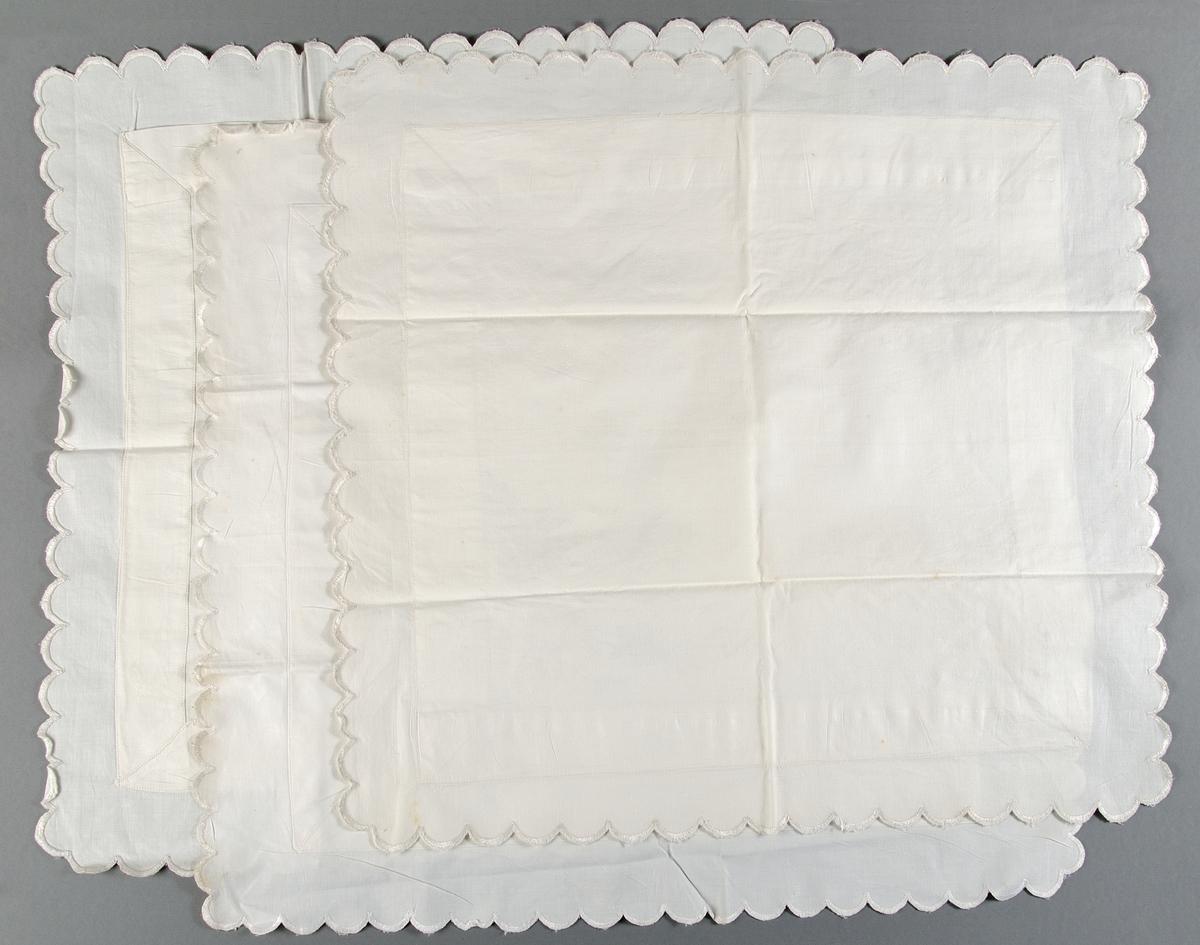 Örngott av vit bomullslärft. Broderi i två motställda hörn, blombukett i vitt bomullsgarn, plattsöm, stjälksöm och knutsöm. Uddkant med langettsöm runtom. Ett örngott (a) har fyra knytband, örngott b-c saknar knytband.