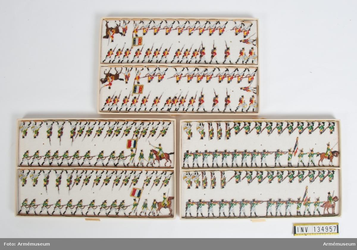 Schweiziskt och irländskt infanteri från Frankrike från Napoleonkrigen. Tre lådor med figurer. Fabriksmålade.