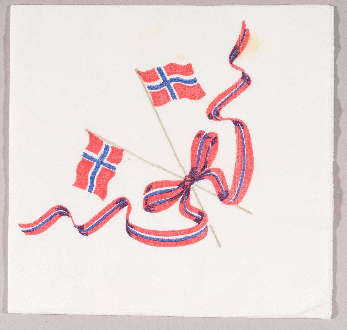 To norske flagg i kryss. Et bånd i blått, rødt og hvitt med sløyfe.