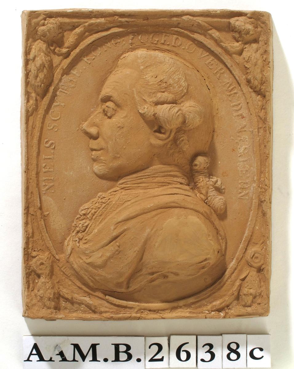 Relieffportrett av foged over Nedenes, Niels Scythe.