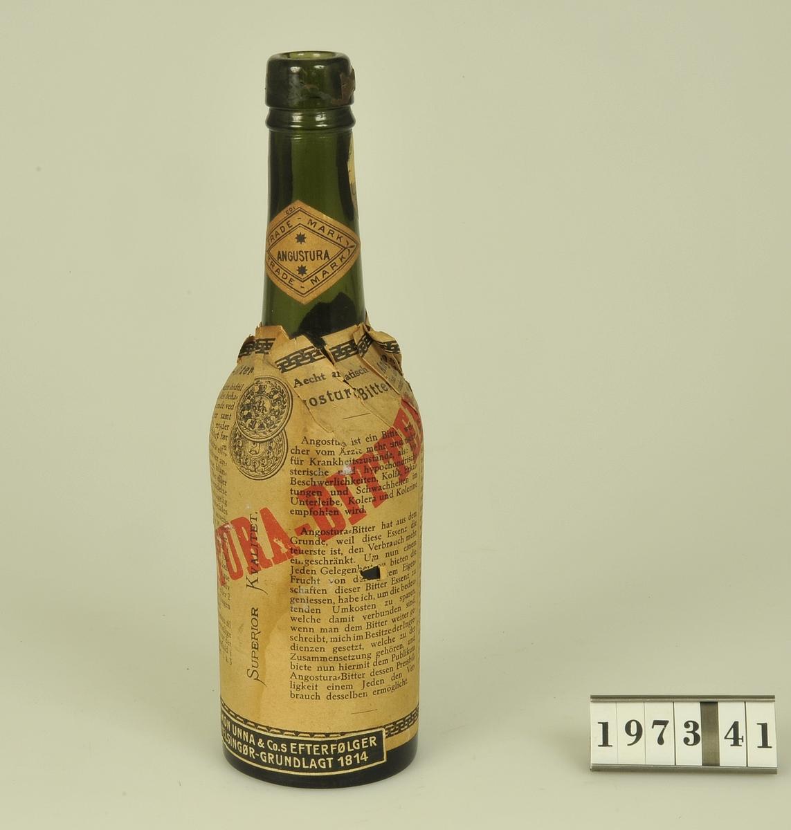 Av grönt glas. Etikett: Angostura-Bitter.              Simon Unna & Co. S Efterfölger.              Helsingör-Grundlagt 1814.