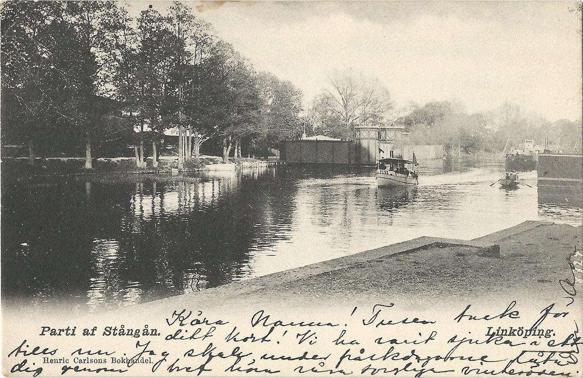 Vykort från  Linköping  parti av Stångån. Kinda kanal, Stångån,  hamnen, Stångebro , kallbadhus, kallbadhuset, Poststämplat 2 april 1904 Henric Carlsons bokhandel Linköping