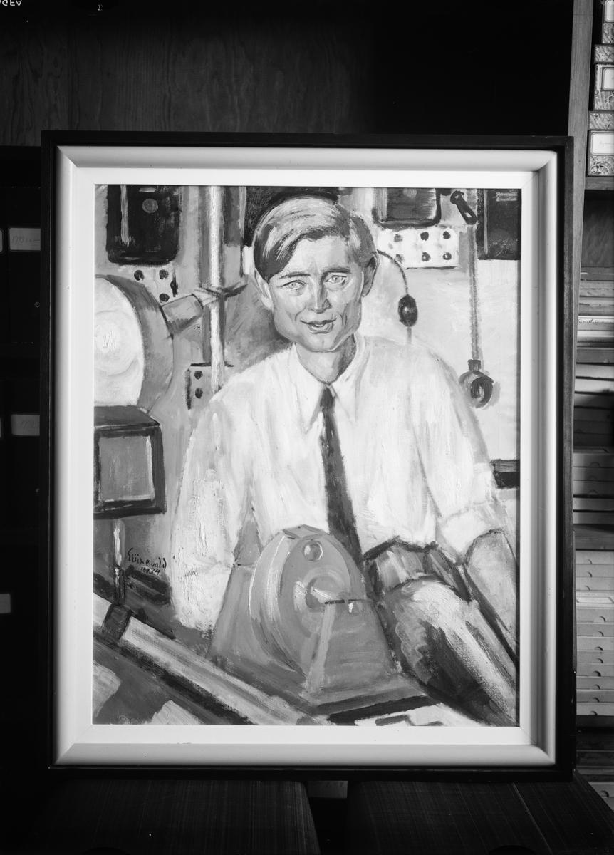 Oljemålning - konstnären Isaac Grünewalds porträtt av professor The Svedberg, placerat i Fysikalisk-kemiska institutionens bibliotek
