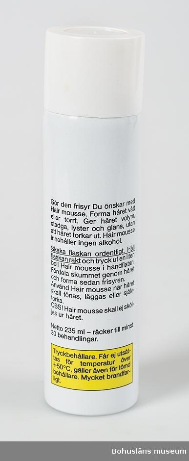Hårmousse från butiken Hennes & Mauritz.  Hårmousse användes till att ge stadga åt frisyren.