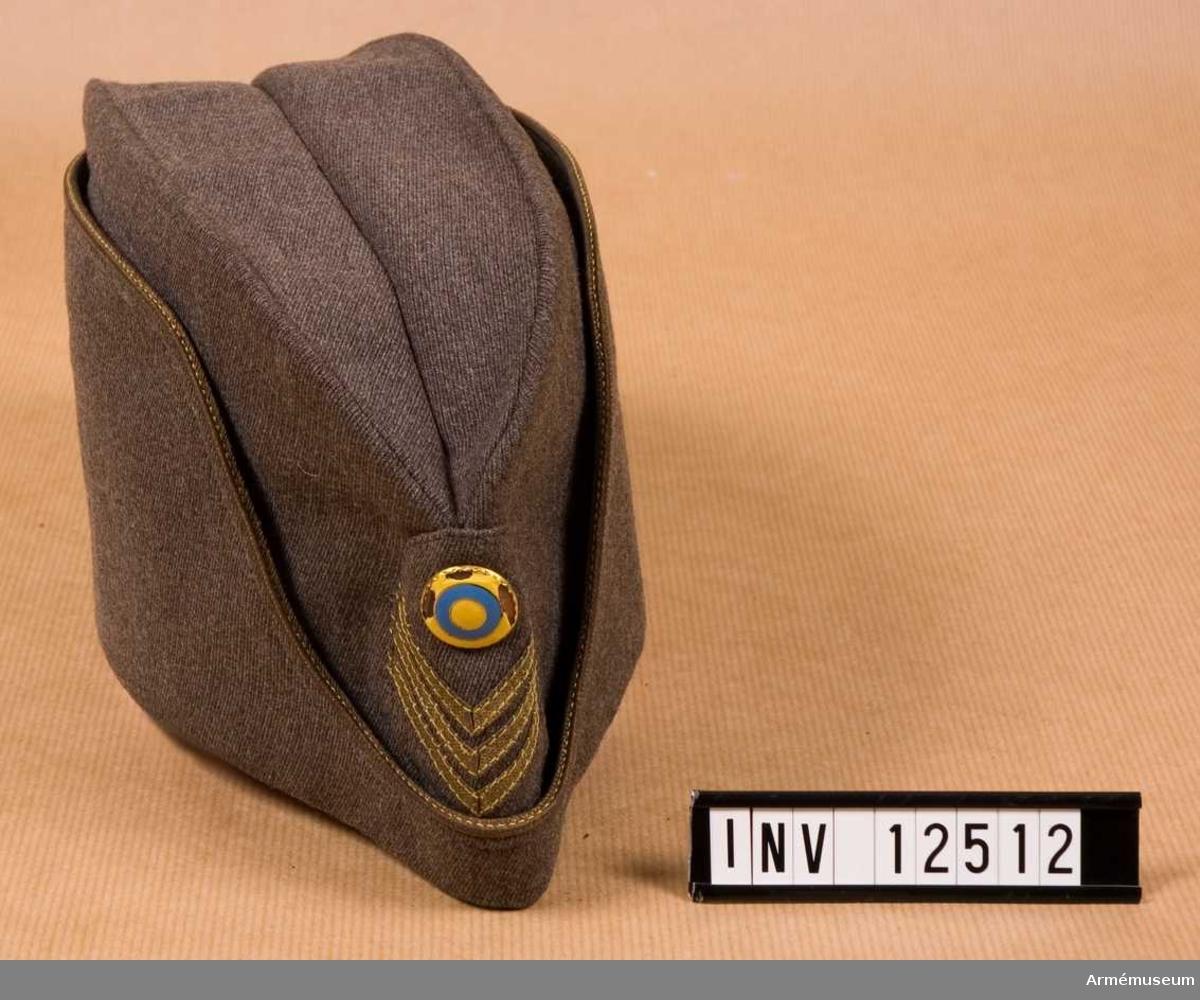 Grupp C I.  Med nationalitetsknapp m/1941. Utan officersknapp.