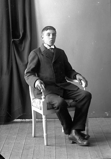 """Enligt fotografens journal nr 4 1918-1922: """"Jansson, Karl Bräcketorp, Spekeröd""""."""