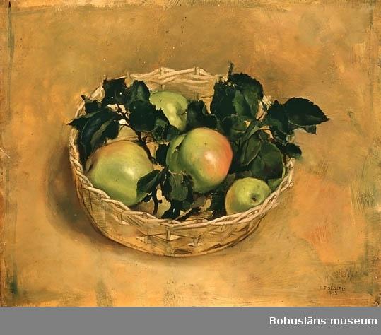 Fyra äpplen i korg