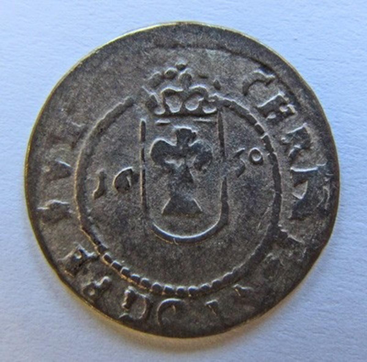 Besittningsmynt,  Kristina, 1 öre silvermynt. Präglat 1650 i Reval (Tallin) som var svensk mellan åren 1561-1710.