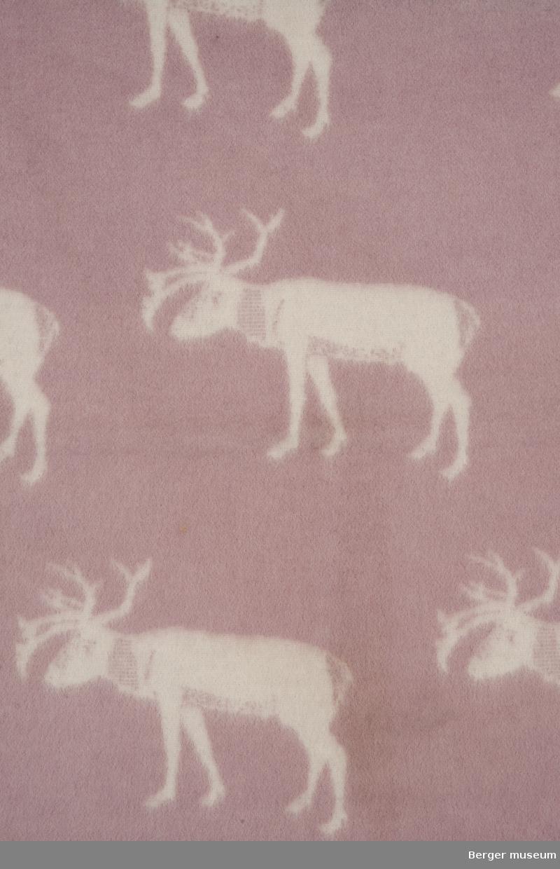Hvite reinsdyr på rosa bunn.