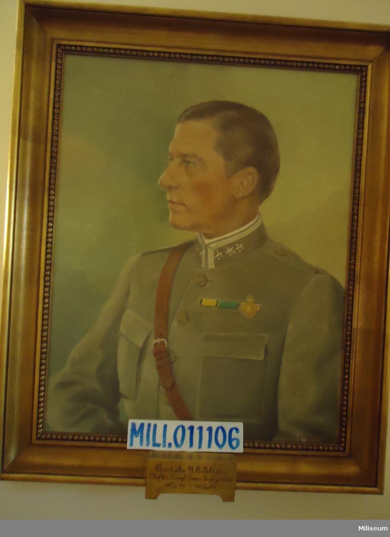 Porträtt i olja på duk av G E Ström, inramad i förgylld träram.