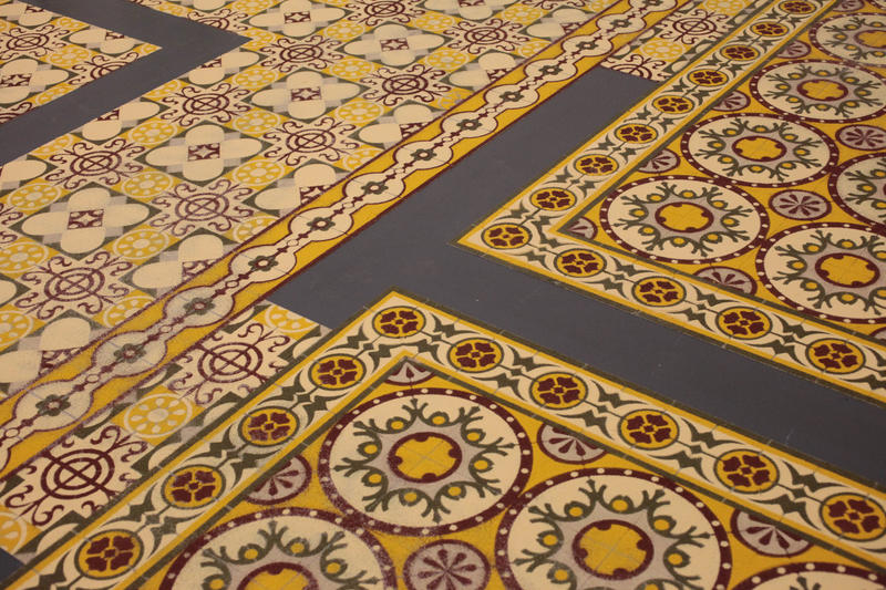 Work on the floor that resembles coloured ceramic tiles, actually made of different spices