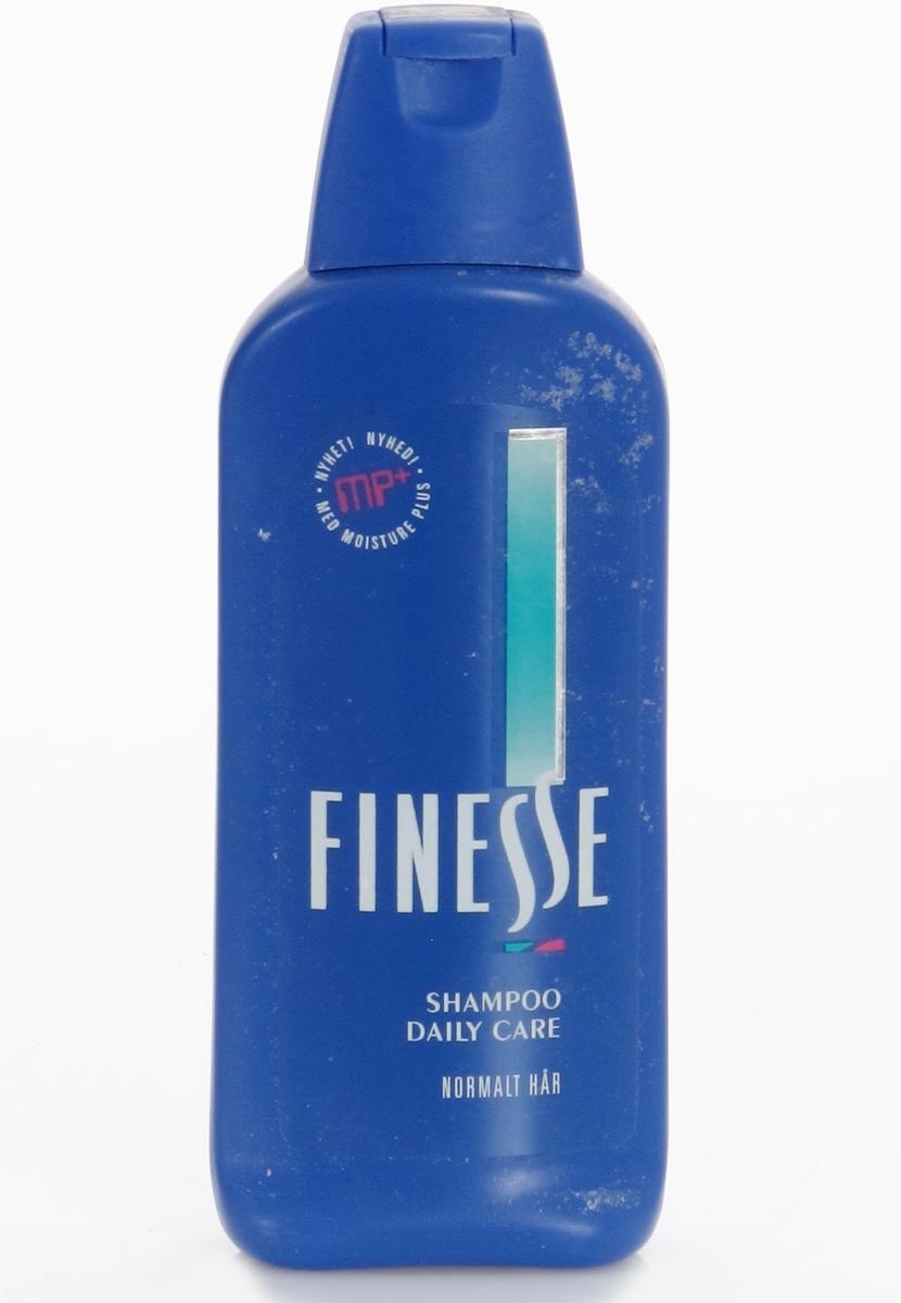 Plastfalske for hårshampoo. Blå flaske, kork med klikklukning.