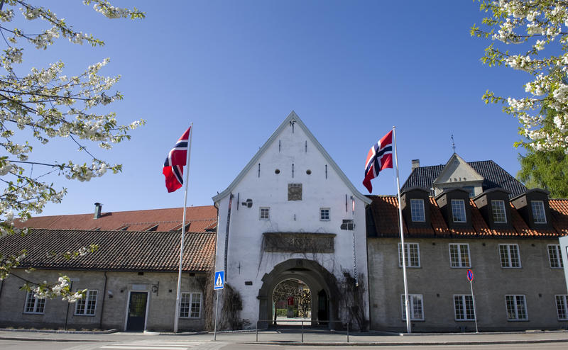 Norsk Folkemuseum's main entrance with two Norwegian flags.