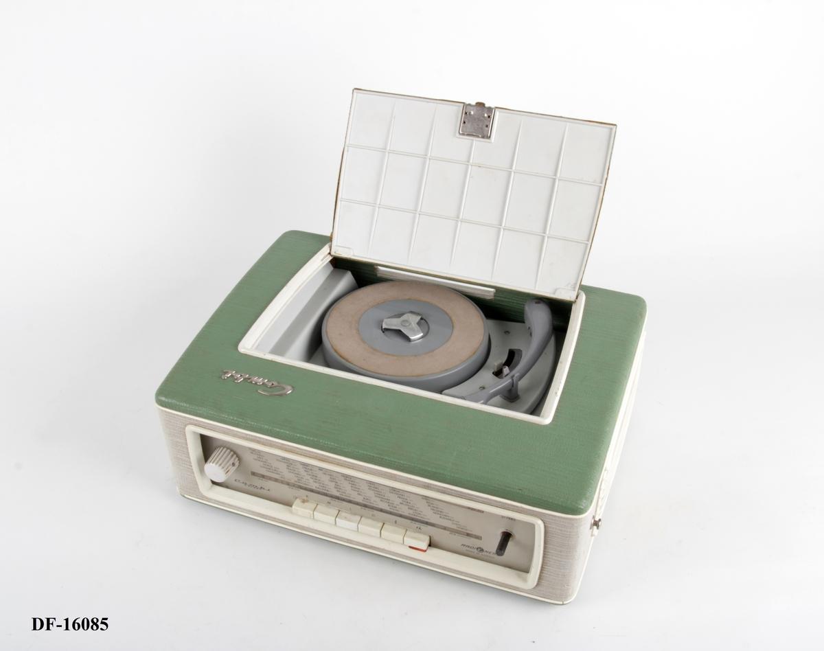 Bærbar reiseradio og gramofonplate-spiller. Søkerskala foran.
