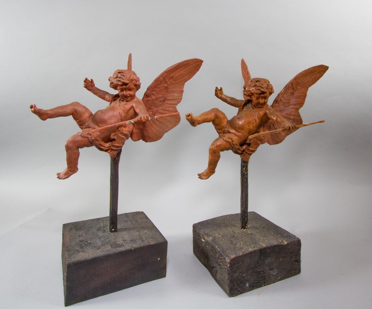Amorin, flygande, med pilbåge i ena handen och pilkoger.