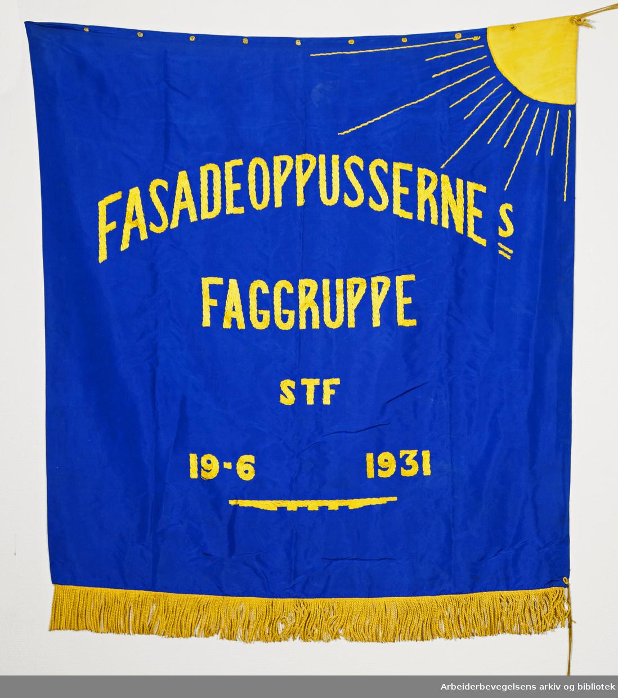 Fasadeoppussernes Faggruppe..Bakside..Fanetekst: Fasadeoppussernes Faggruppe STF.19. 6. 1931