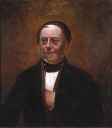 Portrett av Peter Schmidt. Mørk drakt, rødbrun vest, svart halsbind. Rødbrun bakgrunn.