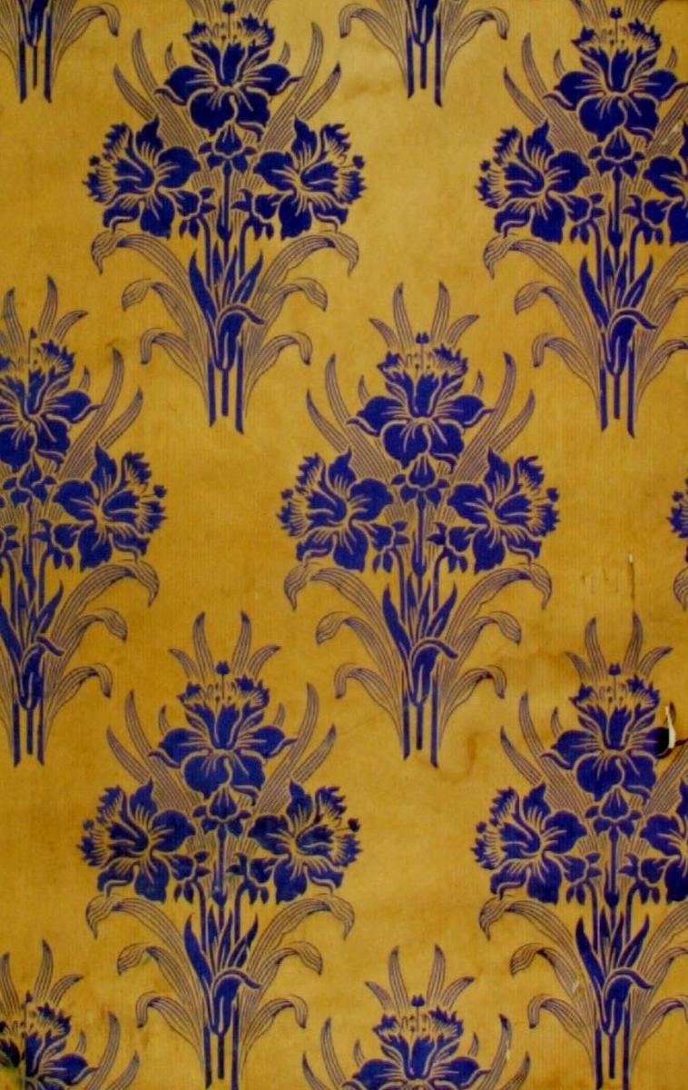 Blombuketter i diagonalupprepning över ett ofärgat papper. Tryck i blått.