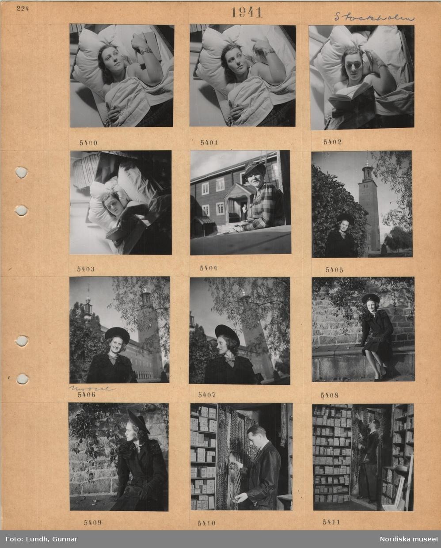 Motiv: Stockholm, kvinnlig modell ligger i en säng, läser i en bok, kvinna i hatt sitter utanför Delsbogården på Skansen, kvinnlig modell i hatt och kappa poserar framför Stockholms stadshus, butikslager, hyllor med askar, en man i skyddsrock hanterar upphängda kedjor.