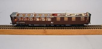 Modell i skala 1:87 av restaurangvagn Ro3a-L Nr 3143.  Modellen är fullt inredd i 1930-talsutförande, och saknar tak, för åskådlighetens skull.  Modell/Fabrikat/typ: Ho