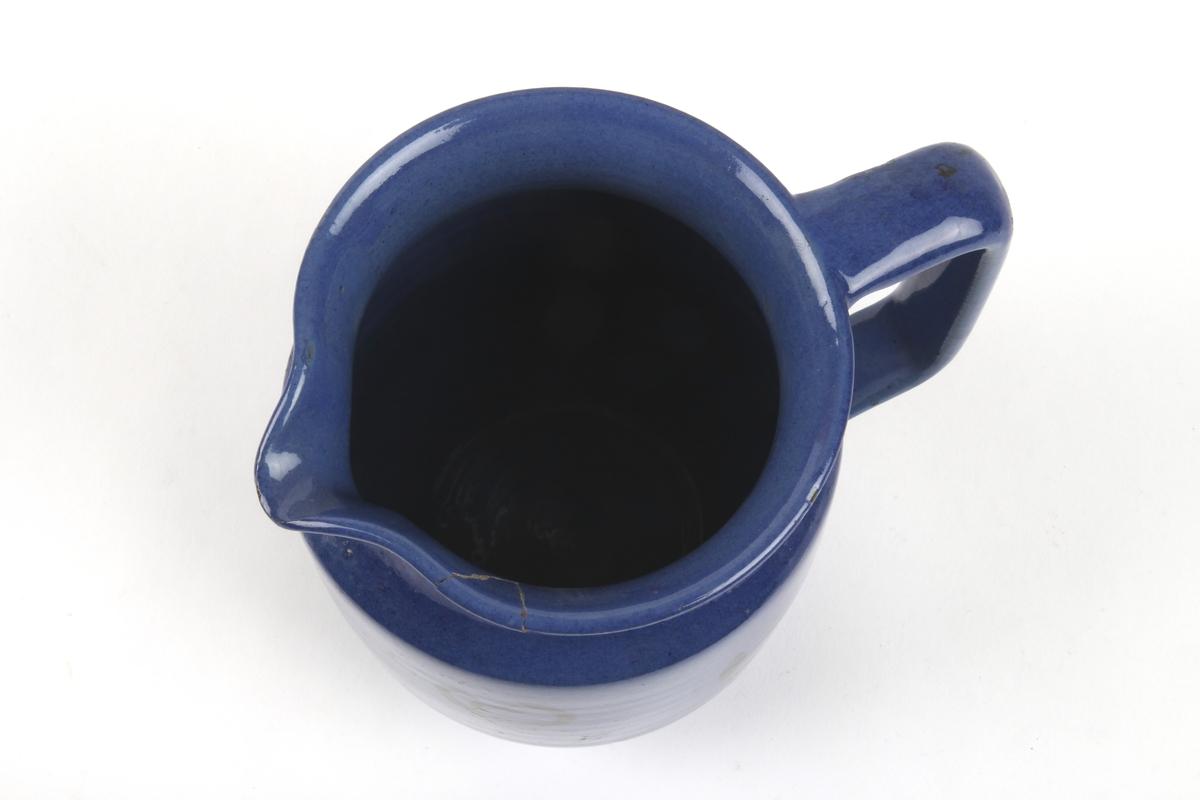 Blå mugge med sort dekor