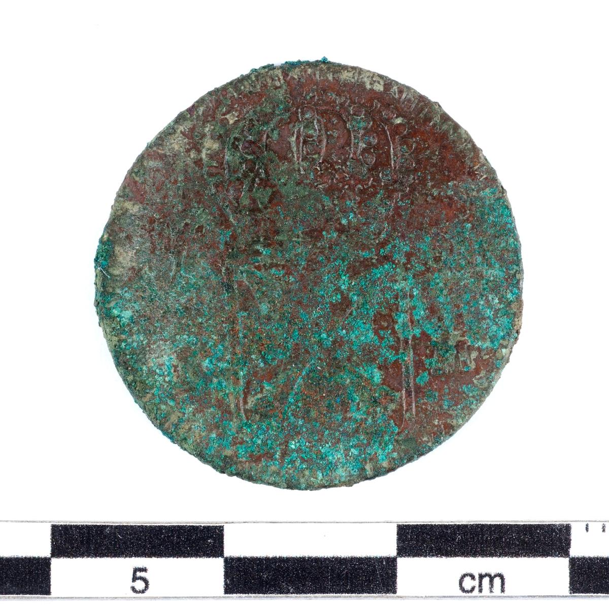 Mynt av kopparlegering. 1/6 öre, lite osäkert. Eventuellt präglat 1716.