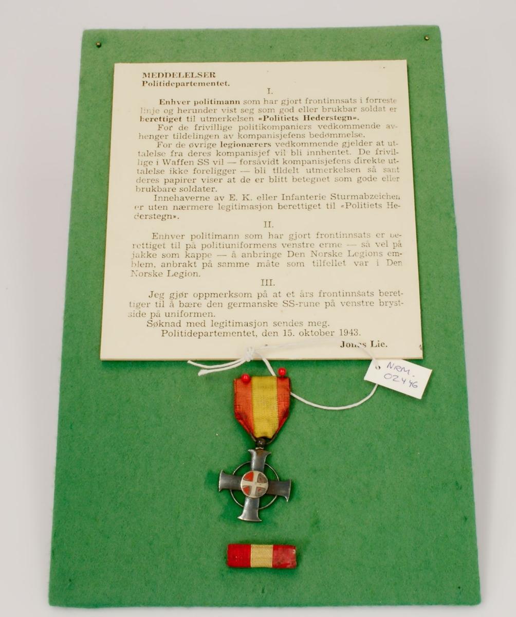 Medalje og miniatyr. Bronsekors med Nasjonal Samlings emblem, solkorset i rødt og gull. Korset har et rødt bånd med gul stripe. Miniatyr i rødt og gult.